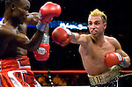 Uncasville, CT: (r-l) Paulie Malignaggi lands on  Lovemore N'Dou during their IBF Junior Welterweight Championship at the Mohegan Sun casino, June 16th, 2007. Malignaggi won the belt from N'Dou by unanimous decision.. Photo by Thierry Gourjon.