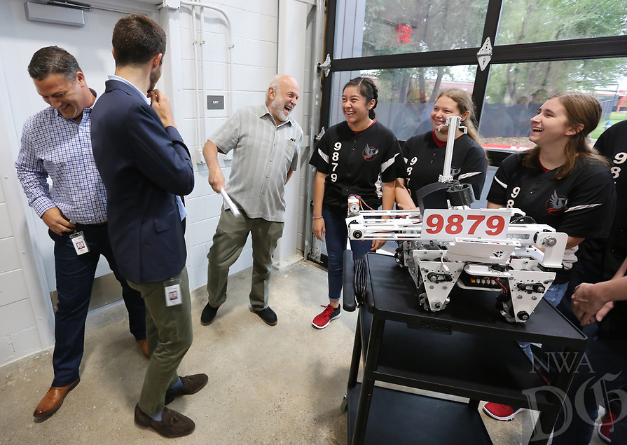 NWA Democrat-Gazette/DAVID GOTTSCHALK John Tyson (center), chairman of the board Tyson Foods, Inc., enjoys time with the robotics team from the Don Tyson School of Innovation Thursday, August 8, 2019, before an unveiling ceremony at the new Tyson Foods Manufacturing and Automation Center in Springdale. The center will provide space for the development of new manufacturing solutions, collaboration with equipment suppliers and worker training on new technology.