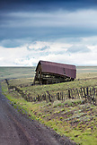 USA, Oregon, Joseph, an old barn along the road that leads to the Zumwalt Prairie Preserve in Northeast Oregon, looking towards the Eagle Cap Wilderness and the Wallowa Mountains, Wallowa-Whitman National Forest