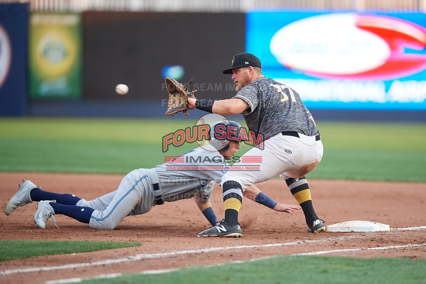 Quad Cities River Bandits first baseman Colton Shaver (37) waits to receive a pick off throw as Kody Clemens (21) dives back towards the base during a game against the West Michigan Whitecaps on July 22, 2018 at Modern Woodmen Park in Davenport, Iowa.  West Michigan defeated Quad Cities 6-4.  (Mike Janes/Four Seam Images)