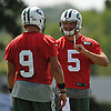 Christian Hackenberg #5, right, chats with fellow quarterback Bryce Petty #9 during the first day of New York Jets team training camp at Atlantic Health Jets Training Center in Florham Park, NJ on Thursday, July 28, 2016.