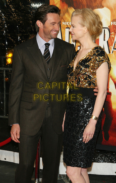 "HUGH JACKMAN & NICOLE KIDMAN .New York Premiere of ""Australia"" at the Ziegfeld Theater, New York, NY, USA..November 24th, 2008.half length brown suit jacket 3/4 black gold sequins sequined dress dress skirt top profile .CAP/LNC/TOM.©TOM/LNC/Capital Pictures."