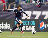 New England Revolution midfielder Chris Tierney (8) brings the ball forward. In a Major League Soccer (MLS) match, the New England Revolution tied Toronto FC, 0-0, at Gillette Stadium on June 15, 2011.