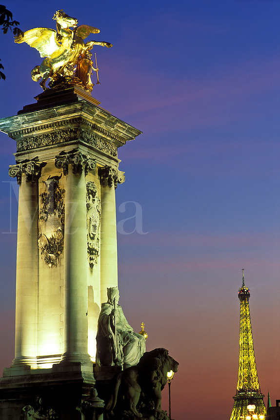 France, Paris, Pont Alexandre III and the Eiffel Tower illuminated at night