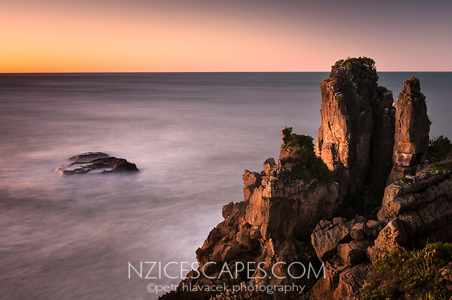 Pancake rocks, limestone formations on rugged coast in Punakaiki during sunset, Paparoa National Park, Buller Region, West Coast, New Zealand, NZ