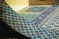 Topkapi Palace: Istanbul.  Court of the Pool-Harem.  17th century tilework ordered by Sultan Mehmed IV (1648-87). The inscriptions in roundels all contain pious utterances. The frieze commemorates the restoration of Harem after fire.