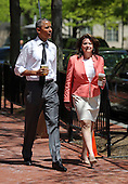 United States President Barack Obama walks with the 2015 National Teacher of the Year, Shana Peeples of Texas, near the White House after picking up a carry-out snack following a Rose Garden ceremony, in Washington, Wednesday, April 29, 2015.<br /> Credit: Martin H. Simon / Pool via CNP