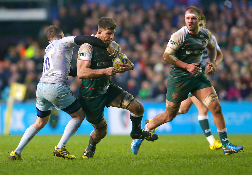 Leicester Tigers' Mike Fitzgerald is tackled by Northampton Saints' JJ Hanrahan<br /> <br /> Photographer Rachel Holborn/CameraSport<br /> <br /> Rugby Union - Aviva Premiership Round 9 - Leicester Tigers v Northampton Saints - Saturday 9th January 2016 - Welford Road - Leicester<br /> <br /> &copy; CameraSport - 43 Linden Ave. Countesthorpe. Leicester. England. LE8 5PG - Tel: +44 (0) 116 277 4147 - admin@camerasport.com - www.camerasport.com