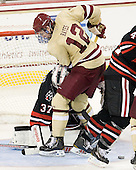 Chris Rawlings (NU - 37), Kevin Hayes (BC - 12) - The Boston College Eagles defeated the visiting Northeastern University Huskies 3-0 after a banner-raising ceremony for BC's 2012 national championship on Saturday, October 20, 2012, at Kelley Rink in Conte Forum in Chestnut Hill, Massachusetts.