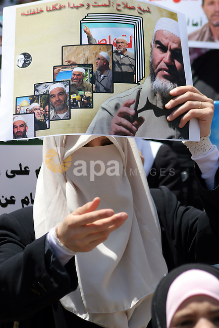 Supporters of Sheikh Raed Salah, head of the radical wing of the Islamic Movement in Israel, demonstrate outside the Red Cross office in the West Bank city of Hebron, on July 03 ,2011 after the controversial Arab-Israeli Islamist leader was arrested in London for entering the country despite a government ban and now faces deportation from Britain. Photo by Najeh Hashlamoun.