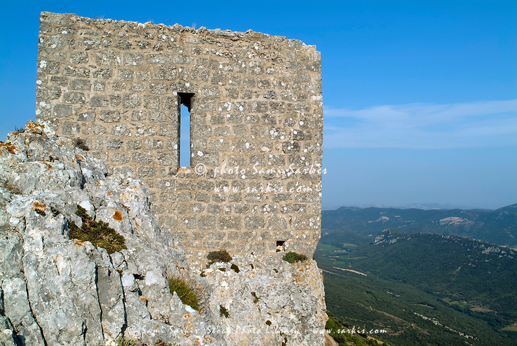Old stone wall at Peyrepertuse, a ruined fortress located high in the French Pyrenees, Aude, France.