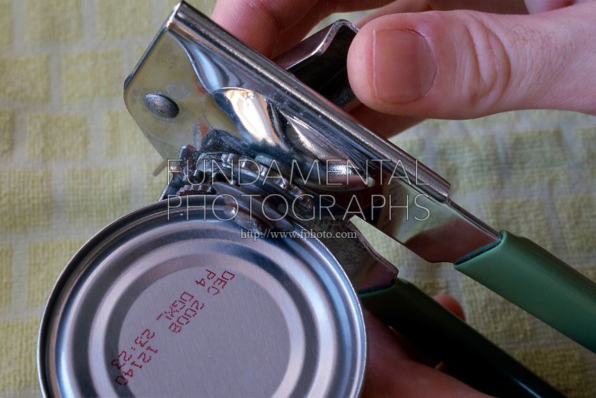 MANUAL CAN OPENER IN USE<br /> Can opener<br /> A complex machine, which combines a lever (the hinged handle), a wheel and axle (the turning knob), and a wedge (the sharpened cutting disk).
