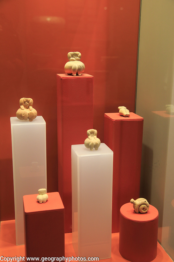 Ggantija temples visitor centre display museum, Gozo, Malta small carved stone human figurines and snail
