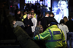 """© Joel Goodman - 07973 332324 . 19/12/2015 . Manchester , UK . A man leans over a wall overlooking a canal at Deansgate Locks . Revellers in Manchester enjoy """" Mad Friday """" - also known as """" Black Eye Friday """" - the day on which emergency services in Britain are typically at their busiest , as people head out for parties and drinks to celebrate Christmas . Photo credit : Joel Goodman"""