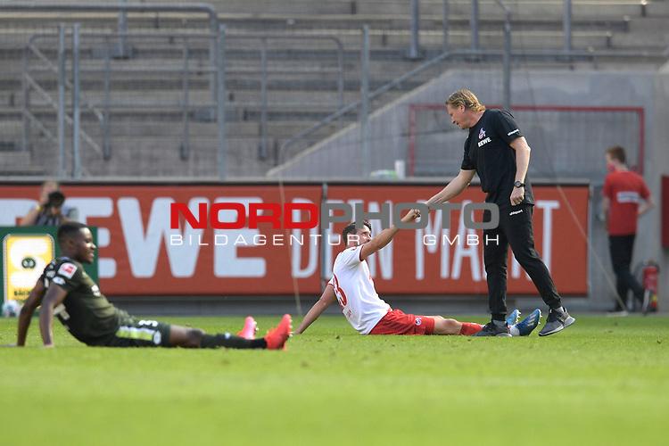 nph00351: Markus GISDOL (Trainer 1.FC Koeln) mit <br /> Jonas HECTOR (1.FC Koeln)<br /> nach Spielende,,<br /> Sport: Fussball: 1. Bundesliga: Saison 19/20: 26.Spieltag: 1.FC KOELN-FSV MAINZ 05,17.05.2020.<br /> Foto: Anke Waelischmiller/SVEN SIMON/POOL / via Meuter/nordphoto<br /> <br /> Nur für journalistische Zwecke! Only for editorial use!<br /> Gemäß den Vorgaben der DFL Deutsche Fußball Liga ist es untersagt, in dem Stadion und/oder vom Spiel angefertigte Fotoaufnahmen in Form von Sequenzbildern und/oder videoähnlichen Fotostrecken zu verwerten bzw. verwerten zu lassen. DFL regulations prohibit any use of photographs as image sequences and/or quasi-video.