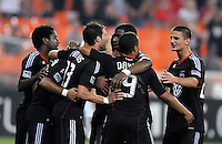 D.C. United defender Daniel Woolard (21) celebrates with teammate his score. D.C. United defeated The Vancouver Whitecaps FC 4-0 at RFK Stadium, Saturday August 13 , 2011.