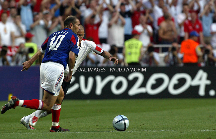 France´s player Zidane vies with David Beckham during  the Euro 2004 Championships football  match on 21 June, 2004