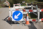 Blue direction arrow road sign at roadworks, Suffolk, England