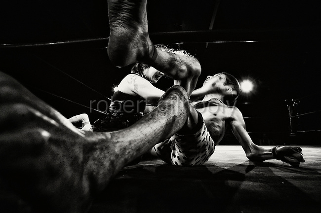 Wrestlers do battle during a bout  at Doglegs, an event for wrestlers with physical and mental challenges in Tokyo, Japan.