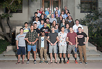 Group photo of Physics Department students, faculty and staff on the steps of the Academic Commons, Mary Norton Clapp Library Nov. 4, 2014. (Photo by Marc Campos, Occidental College Photographer)