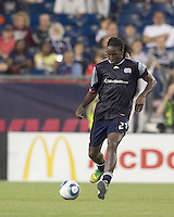 New England Revolution forward Shalrie Joseph (21) passes the ball. In a Major League Soccer (MLS) match, the Los Angeles Galaxy defeated the New England Revolution, 1-0, at Gillette Stadium on May 28, 2011.