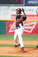 Hickory Crawdads starting pitcher Akeem Bostick (23) in action against the Charleston RiverDogs at L.P. Frans Stadium on May 25, 2014 in Hickory, North Carolina.  The RiverDogs defeated the Crawdads 17-10.  (Brian Westerholt/Four Seam Images)