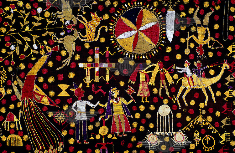 Detail of a wedding shawl (Phulkari) showing dowry jewellery on bottom right.