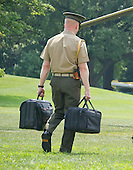 A United States Marine carries the bags containing the nuclear codes as US President Barack Obama and members of the first family departs the White House in Washington, DC on Saturday, August 6, 2016 to travel to Martha's Vineyard, Massachusetts for their annual two week vacation.  <br /> Credit: Ron Sachs / Pool via CNP