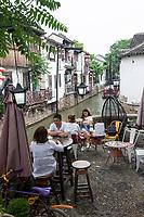 Suzhou, Jiangsu, China.  Shantang District.  People Relaxing over Refreshments along the Shantang Canal.