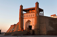 Low angle view of the entrance to the Ark citadel, 5th century, Bukhara, Uzbekistan, pictured on July 11, 2010, at sunset. Situtaed on an artificial hill of 9,2 hectares, it was the internal fortress of Bukhara and according to legend dates as far back as the early 1st century AD. Bukhara, a city on the Silk Route is about 2500 years old. Its long history is displayed both through the impressive monuments and the overall town planning and architecture.