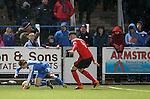 Rob Kiernan bundles over Aidan Smith outside the box