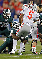 Ohio State Buckeyes quarterback Braxton Miller (5) gets sacked by Michigan State Spartans safety Isaiah Lewis (9) in the 1st quarter during the Big 10 Championship game at Lucas Oil Stadium in Indianapolis, Ind on December 7, 2013.  (Dispatch photo by Kyle Robertson)