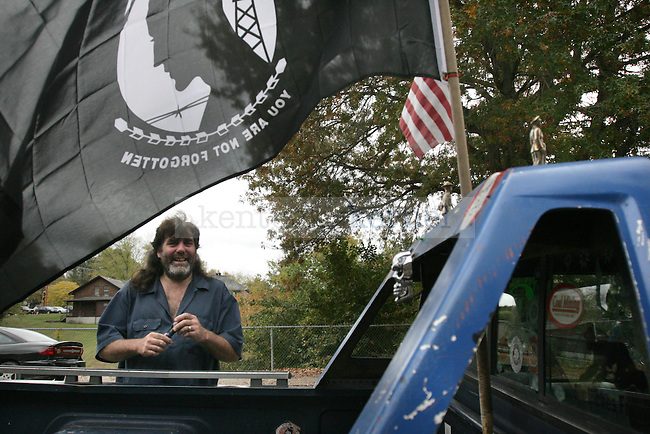Larry Gene Smith, a Pikeville, Ky., native who lives in downtown Jackson, Ky., is a supporter of veterans and POWs because of friends and family members involved in the military. His pickup truck, decorated with flags and stickers, is parked outside his house in Jackson on Wednesday, Oct. 12, 2011.