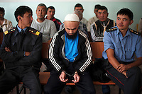Imonakunov Seitbek, 34, sits, head bowed and handcuffed, at the Aksuu Rayon Court during his trial. He kidnapped Kasymbay Urus and although she was taken back home two days later by her family, she hanged herself in the backyard of her home in the early morning of the following day. Imanakunov Seitbek was sentenced  to be imprisoned for six years for the crime of kidnapping a woman and rape. Although illegal, bride kidnapping is common in rural parts of Kyrgyzstan. Each year around 16, 000 women become married after being kidnapped. They are known as 'Ala Kachuu' that translates as 'to grab and run away'. Defenders of the continuation of the practice sight tradition. However, during Soviet Times it was rare, and parents generally arranged marriages..