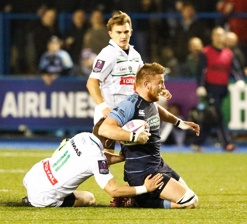 Cardiff Blues' James Down is tackled by Pau's Marvin Lestremau<br /> <br /> Photographer Simon King/CameraSport<br /> <br /> Rugby Challenge Cup Pool 4 - Cardiff Blues v Pau - Friday 21st October 2016 - Cardiff Arms Park - Cardiff <br /> <br /> World Copyright &copy; 2016 CameraSport. All rights reserved. 43 Linden Ave. Countesthorpe. Leicester. England. LE8 5PG - Tel: +44 (0) 116 277 4147 - admin@camerasport.com - www.camerasport.com