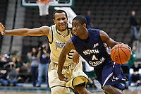 February 08, 2011:    North Florida Ospreys guard William Wilson (4) drives past Jacksonville Dolphins guard Alyos Cabell (15) during Atlantic Sun Conference action between the Jacksonville Dolphins and the North Florida Ospreys at Veterans Memorial Arena in Jacksonville, Florida.  Jacksonville defeated North Florida 71-69.