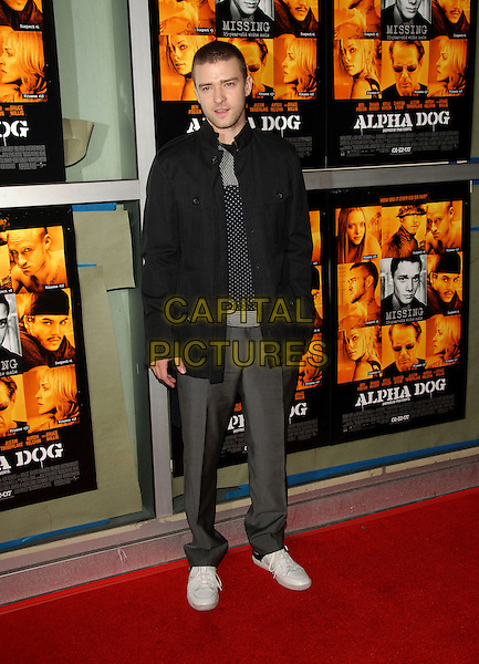 """JUSTIN TIMBERLAKE.Universal Pictures World Premiere of """"Alpha Dog"""" held at The Arclight Theatre in Hollywood, California, USA. .January 3rd, 2007.full length black jacket grey gray trousers white sneakers trainers.CAP/DVS.©Debbie VanStory/Capital Pictures"""