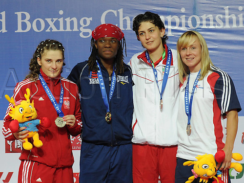 19.05.2012. Qinhuangdao China.  Gold medalist Tiara  Brown L2 of The United States Silver medalist Sandra Krystyna Kruk l of Poland Bronze medalist Lisa Jane Whiteside of England and Svetlana  Staneva of Bulgaria Pose on The Podium during The Awards Ceremony for for womens 57kg AT The AIBA Elite Women World Championship in Qinhuangdao North Chinas Hebei Province