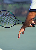 closeup of a man with tennis racket in hand