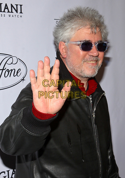 PEDRO ALMODOVAR.Parmigiani Watches & Raffone Luggage Sony Pictures Classics Oscar Party  held at II Cielo Restaurant, Beverly Hills, California, USA..March 6th, 2010.half length jacket black leather beard facial hair sunglasses shades hand palm waving .CAP/ADM/TC.©T. Conrad/AdMedia/Capital Pictures.