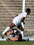 Texas A&M's Kristin Arnold (below) grabs the ball off of the feet of North Carolina's Robyn Gayle (11) on Saturday, November 25th, 2006 at Fetzer Field in Chapel Hill, North Carolina. The University of North Carolina Tarheels defeated the Texas A&M Aggies 3-2 in an NCAA Division I Women's Soccer Championship quarterfinal game.
