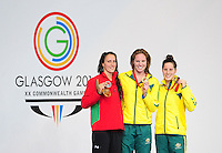 The women's 100m backstroke podium, from left, silver medalist Wales' Georgia Davies, gold medalist Australia's Emily Seebohm and bronze medalist Australia's Belinda Hocking<br /> <br /> Photographer Chris Vaughan/CameraSport<br /> <br /> 20th Commonwealth Games - Day 3 - Saturday 26th July 2014 - Swimming - Tollcross International Swimming Centre - Glasgow - UK<br /> <br /> © CameraSport - 43 Linden Ave. Countesthorpe. Leicester. England. LE8 5PG - Tel: +44 (0) 116 277 4147 - admin@camerasport.com - www.camerasport.com
