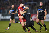 Scott Williams of the Scarlets is tackled by Sam Underhill of Bath Rugby. European Rugby Champions Cup match, between Bath Rugby and the Scarlets on January 12, 2018 at the Recreation Ground in Bath, England. Photo by: Patrick Khachfe / Onside Images