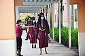 PEMBROKE PINES, FL - MAY 15: Melissa Fernandez directs students wearing protective masks as they wait six feet apart during the graduation ceremony at Pembroke Pines Charter High School on May 15, 2020 in Pembroke Pines, Florida. Because of social distancing mandates instituted by the state to curtail the spread of COVID-19, the 2020 graduates received their diplomas in a near-empty auditorium with no friends, family or relatives allowed to attend. A video of each student walking the stage to receive their diploma will be streamed on the school's scheduled graduation date of May 29.  ( Photo by Johnny Louis / jlnphotography.com )