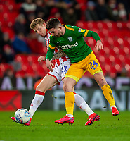 12th February 2020; Bet365 Stadium, Stoke, Staffordshire, England; English Championship Football, Stoke City versus Preston North End; James McClean of Stoke City tackles Sean Maguire of Preston North End - Strictly Editorial Use Only. No use with unauthorized audio, video, data, fixture lists, club/league logos or 'live' services. Online in-match use limited to 120 images, no video emulation. No use in betting, games or single club/league/player publications