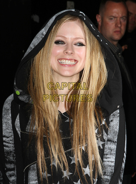 Avril Lavigne.JustFabulous And Abbey Dawn By Avril Lavigne Partnership Launch Party Held At The The Viper Room, West Hollywood, California, USA..March 13th, 2012.half length black jacket grey gray stars stripes top eyeliner make-up smiling hood hooded .CAP/ADM/KB.©Kevan Brooks/AdMedia/Capital Pictures.