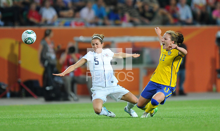 Kelley O'Hara (l) of team USA and Antonia Goransson of team Sweden during the FIFA Women's World Cup at the FIFA Stadium in Wolfsburg, Germany on July 6thd, 2011.