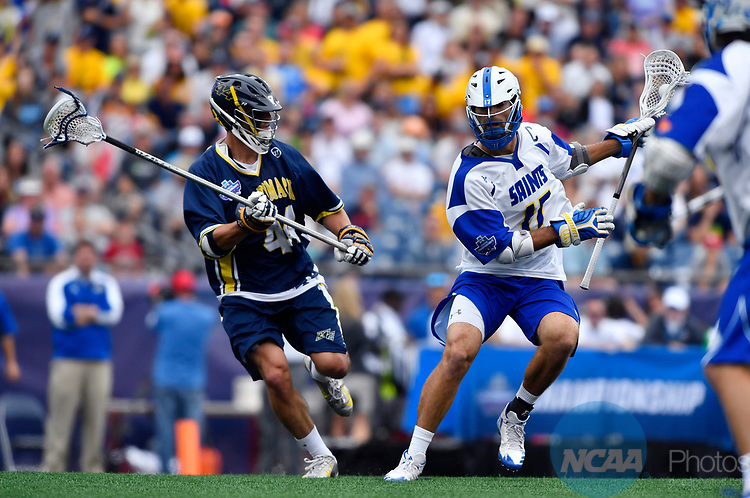 FOXBORO, MA - MAY 28: Bailey Bourgeois (11) of the Limestone Saints attempts to run past Brennen Morin (44) of the Merrimack Warriors during the Division II Men's Lacrosse Championship held at Gillette Stadium on May 28, 2017 in Foxboro, Massachusetts. (Photo by Larry French/NCAA Photos via Getty Images)