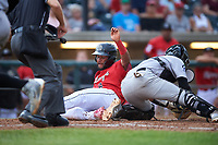 Billings Mustangs Quin Cotton (6) slides across home plate ahead of the tag from Ronaiker Palma (47) during a Pioneer League game against the Grand Junction Rockies at Dehler Park on August 14, 2019 in Billings, Montana. Grand Junction defeated Billings 8-5. (Zachary Lucy/Four Seam Images)