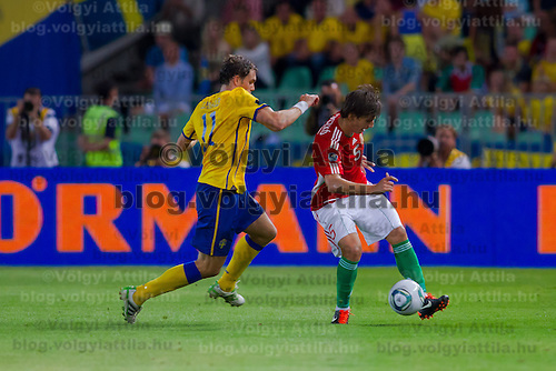 Sweden's Johan Elmander (L) and Hungary's Zsolt Laczko (R) fight for the ball during the UEFA EURO 2012 Group E qualifier Hungary playing against Sweden in Budapest, Hungary on September 02, 2011. ATTILA VOLGYI